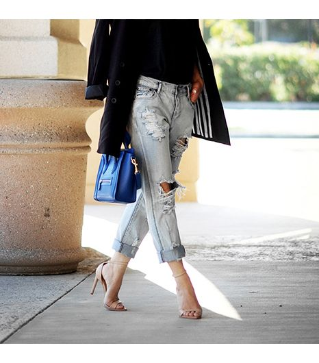 a light distressed denim is something you don't see often.  The nude heel completes this uber chic look